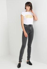 Calvin Klein Jeans - CKJ 010 HIGH RISE SKINNY  - Skinny džíny - stockholm grey - 1