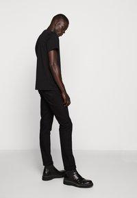 Just Cavalli - SPARKLY SKULL - T-shirt print - black - 6
