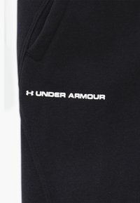 Under Armour - RIVAL - Tracksuit bottoms - black/white - 3