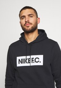 Nike Performance - FC HOODIE - Felpa con cappuccio - black - 3