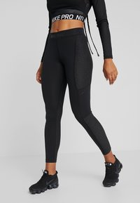 Nike Performance - WARM HOLLYWOOD - Leggings - black/clear - 0
