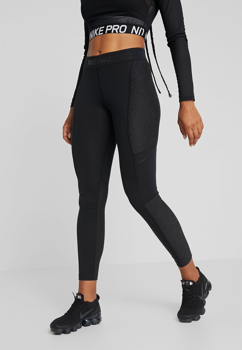 Nike Performance - WARM HOLLYWOOD - Leggings - black/clear