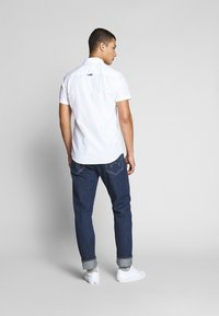 Tommy Jeans - SHORTSLEEVE SHIRT - Chemise - white - 2