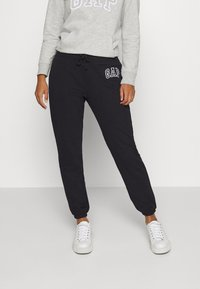 GAP - Tracksuit bottoms - true black
