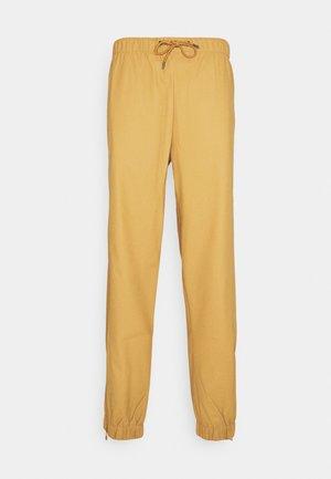 UNISEX - Trousers - khaki