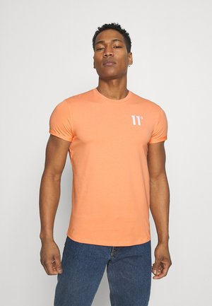 MUSCLE FIT - T-shirt print - coral peach