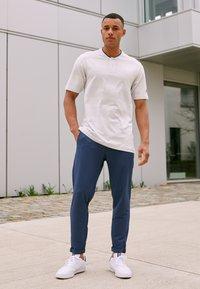 adidas Golf - PRIME - Triko spotiskem - white/grey - 1
