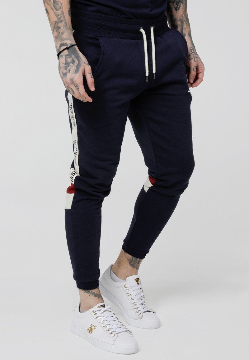 SIKSILK - RETRO PANEL TAPE - Spodnie treningowe - navy/red/off white