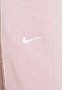 Nike Sportswear - Tracksuit bottoms - champagne - 5