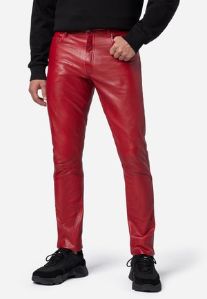 SLIM FIT - Leather trousers - rot