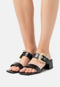 Versace Jeans Couture - Heeled mules - nero - 0