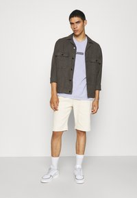 BDG Urban Outfitters - PREHISTORIC TEE UNISEX - T-shirt imprimé - lilac - 1