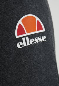 Ellesse - QUEENSTOWN - Tracksuit bottoms - dark grey marl