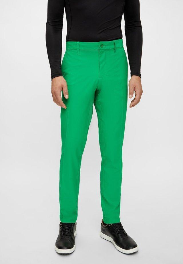 ELLOTT GOLF - Trousers - stan green