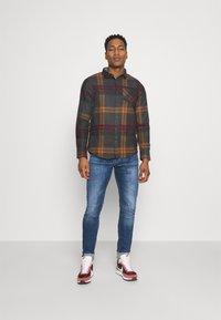 Diesel - SLEENKER - Jeans Skinny Fit - medium blue - 1