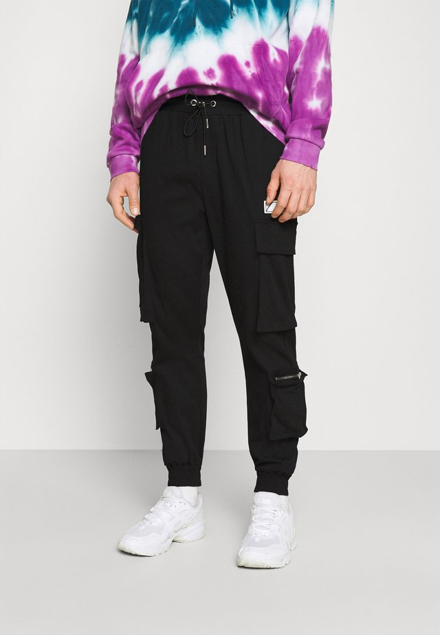 REGULAR CUFFED JOGGER WITH REFLECTIVE DETAILS - Cargo trousers - black