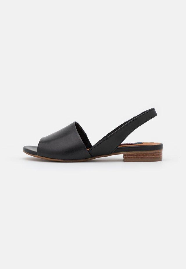 Sandaalit nilkkaremmillä - glove black
