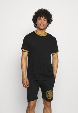 T-shirt con stampa - jet black