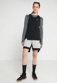 Nike Performance - ELITE TANK - Sports shirt - black/white - 1