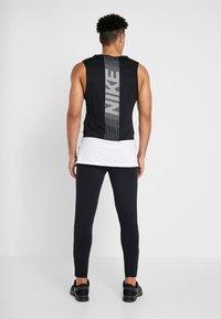 Nike Performance - ESSENTIAL PANT - Tracksuit bottoms - black/reflective silver - 2