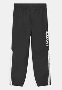 Lacoste Sport - UNISEX - Tracksuit bottoms - noir/blanc - 1