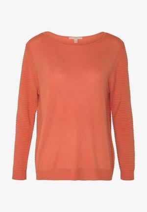 Stickad tröja - burnt orange