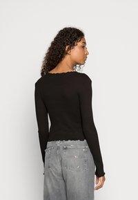 Vero Moda - VMANITA  V-NECK BUTTONS - Long sleeved top - black - 2