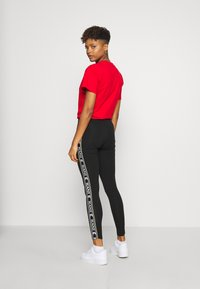 Karl Kani - TAPE TIGHT  - Leggings - Trousers - black - 2