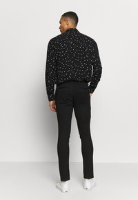 Jack & Jones - JJIMARCO JJPHIL  - Pantalon classique - black - 2