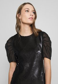KARL LAGERFELD - SEQUINS DRESS WITH PUNTO - Cocktail dress / Party dress - black - 3