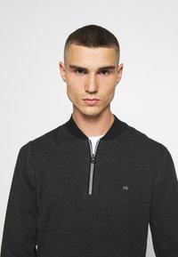 Calvin Klein - BASEBALL ZIP - Stickad tröja - black - 3