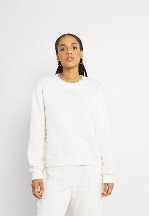 LOGO BASIC - Pantaloni sportivi - pale beige