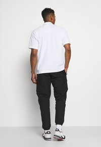 adidas Originals - UTILITY TWO IN ONE ORIGINALS - Pantalon cargo - black - 2