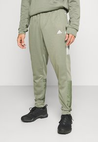 adidas Performance - MUST HAVES AEROREADY SPORTS REGULAR PANTS - Pantalon de survêtement - green - 0