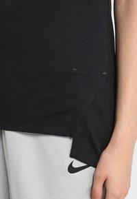 Nike Performance - ELITE TANK - Sports shirt - black/white - 3