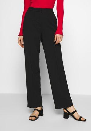 LEA - Trousers - black