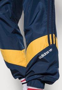 adidas Originals - RIPSTOP TRACK - Donji dijelovi trenirke - collegiate navy - 4