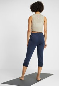 Free People - FP MOVEMENT COUNTERPUNCH CROPPED JOGGER - Tracksuit bottoms - navy - 2