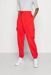 Nike Sportswear - PANT - Tracksuit bottoms - crimson/black - 0