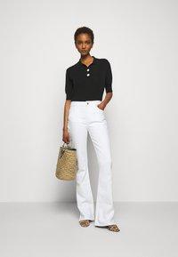 Claudie Pierlot - MINIMA - Poloshirt - noir - 1