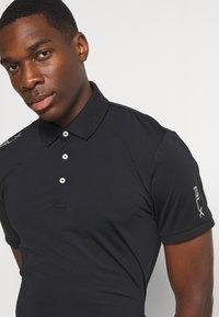 Polo Ralph Lauren Golf - SHORT SLEEVE - Funkční triko - black - 5