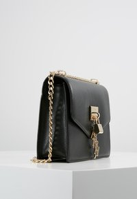 DKNY - ELISSA SHOULDER - Umhängetasche - black/gold - 3