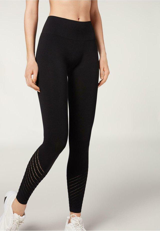 SEAMLESS - Leggings - Trousers - nero