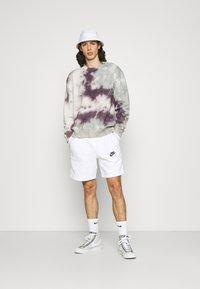 Nike Sportswear - AIR - Träningsbyxor - white/photon dust/black - 1