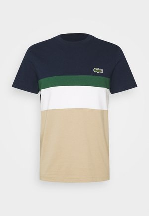T-shirts print - beige/dark blue/dark green