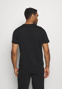 Puma - BOX TEE - Print T-shirt - black - 2