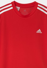 adidas Performance - SET - Sports shorts - vivid red/black/white - 3