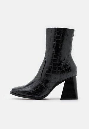 LANIE - Kotníkové boty - black