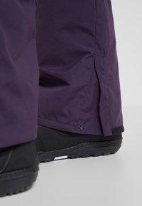Billabong - TUCK KNEE - Snow pants - dark purple - 4