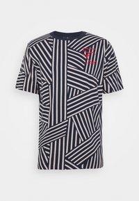 Scotch & Soda - SHORT SLEEVE TEE WITH ALLOVER PRINT - Print T-shirt - blue - 4